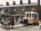 Ice Cream Van on Terraced Street - Manchester 1965 Photographic Print by Shirley Baker