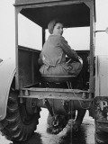 A Land Girl Driving a Tractor on a Farm During World War Ii Photographic Print by Robert Hunt