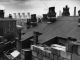 Cooling Towers Through the Rooftops - Manchester Photographic Print by Shirley Baker