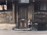 Scruffy Little Boy in a Run-Down Shop Doorway - Manchester Photographic Print by Shirley Baker