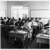 Nevill County Secondary School - a Classroom of Children Sitting at their Desks Photographic Print by Henry Grant