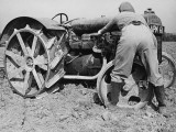Land Girl Working with a Tractor on a Farm During World War I Photographic Print by Robert Hunt