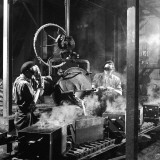 Molten Metal on a Production Line Photographic Print by Heinz Zinram