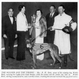 Mrs R.H. Dent with the Greyhound Derby Trophy and Wattle Bark Photographic Print