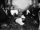 Josephine Baker (1906-75) at Her Bar in Paris, Surrounded by Admirers Photographic Print