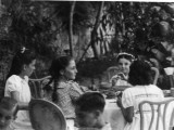 Four Young Italian Girls Sit at a Table with an Elderly Woman Photographic Print by Vanessa Wagstaff
