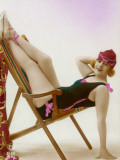 Girl in Bathing Costume Poses in a Rather Uncomfortable Looking Position on Her Deckchair! Photographic Print