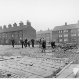 Children in a Deserted Liverpool Street Throw Bricks and Rubble Photographic Print by Henry Grant