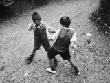 Put 'Em Up!' Two Boys Enjoy a Game of Fisticuffs in a Garden or Playground Photographic Print
