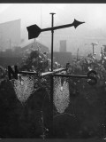 A Spider's Web on a Weathervane Photographic Print