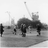Children Playing in an East Glasgow Street with Some Building Machinery in the Background Photographic Print by Henry Grant