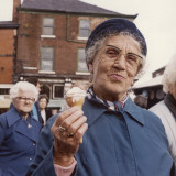 An Elderly Lady with an Ice Cream Cone - Stockport Photographic Print by Shirley Baker