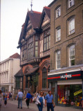 Shoppers Walking Down the Street Between the Shops at Canterbury, Kent Photographic Print by Vanessa Wagstaff