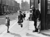 Skipping in the Street - Manchester 1968 Photographic Print by Shirley Baker
