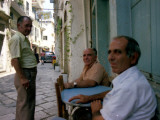 Local People Pass the Time of Day in the Town Centre of Corfu Photographic Print by Vanessa Wagstaff