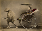 A Japanese Lady with a Parasol Rides in a Rickshaw Pulled by a Coolie Photographic Print