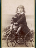 Boy on Tricycle Photographic Print