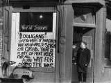 Butcher with Sign to Hooligans - Manchester 1966 Photographic Print by Shirley Baker