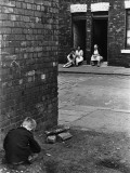 Boy Playing in the Street - Salford, Manchester 1964 Photographic Print by Shirley Baker