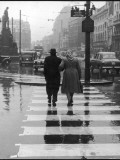 A Typical English Street on a Rainy Shopping Day: an Elderly Couple Use the Zebra Crossing Photographic Print by Henry Grant