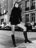 A Girl Wearing a Black Polo- Neck Mini-Dress and Black Knee-High Patent Boots Photographic Print