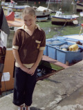 A Little Girl Stands by the Fish Harbour in Kingsbridge, Devon Photographic Print by Vanessa Wagstaff