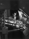 Printing Machine Operator Checks a Proof Photographic Print by Heinz Zinran
