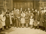 A Wartime Wedding Group Pose in Front of Church Doors Photographic Print by Philip Talmage