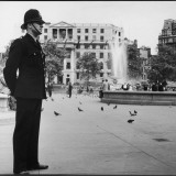 Metropolitan Police Officer on Duty in Trafalgar Square, London Photographic Print