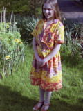 A Young Girl Wearing a 'scooby Doo' Dress Photographic Print by Vanessa Wagstaff