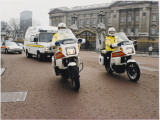 Metropolitan Police Motorcyclists Esccorting an Ambulance Past Buckingham Palace in London Photographic Print