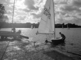 Casting Off a Small Laser Class Sailing Boat at a Boat Club in Surrey Photographic Print by Vanessa Wagstaff