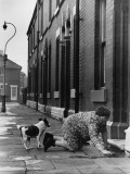 Elderly Lady Washing Her Step - Manchester 1968 Photographic Print by Shirley Baker