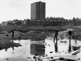 Boys Throwing Rocks into Puddles - Manchester 1966 Photographic Print by Shirley Baker