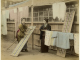 Laundry Day in Japan: Two Women Hang Up Clothes and Fabric to Dry Outdoors Photographic Print