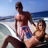 Retro Couple Posing in Beachwear, Bikini, Board Shorts, Stars and Stripes Photographic Print