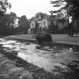 A Country House with a the River Wandle Running Through the Garden Photographic Print by Vanessa Wagstaff