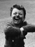 Filthy Young Boy with Broad Grin - Manchester, 1968 Photographic Print by Shirley Baker