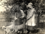 An American Lady and Her Daughter Feeding their Pet Sheep Photographic Print by Vanessa Wagstaff