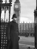 Policeman on Duty Outside the Houses of Parliament and Big Ben in London Photographic Print