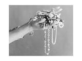 A Pair of Hands Holding All Sorts of Jewellery Photographic Print