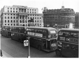 Buses at Trafalgar Squ Photographic Print