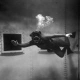 A Scuba Diver Inside a Large Metal Water Tank. Photograph by Heinz Zinram Lámina fotográfica por Heinz Zinram
