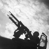 Machine Guns are Ready to Shoot a French Military Plane Photographic Print by Robert Hunt