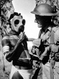 Aborigine Trying on a Gas Mask, Australia, Second World War Photographic Print