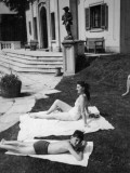 Mother and Son Sunbathing, Italy Photographic Print by Vanessa Wagstaff