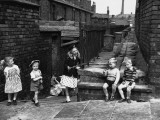 Children Playing in a Back Alley - Salford, Manchester 1962 Photographic Print by Shirley Baker