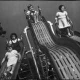 Boys and Girls Play on the Slides at a Playground Photographic Print