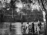 Ice Skaters on River Photographic Print