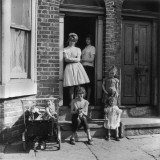 Girls and their Mother Outside Manchester Terraced House Photographic Print by Shirley Baker